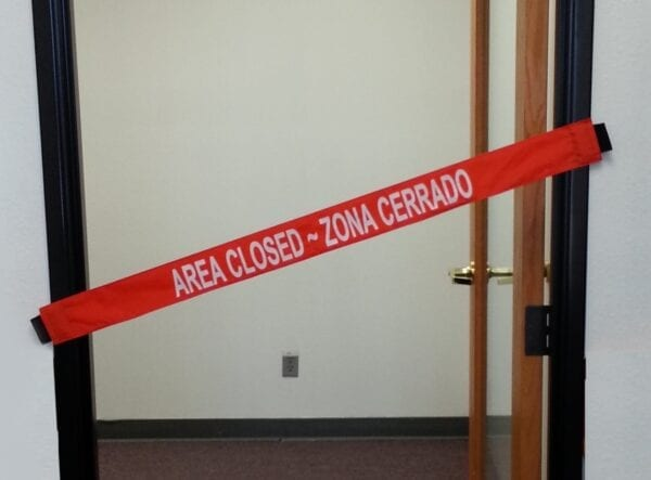 """An """"Area Closed"""" Banner on a Doorway"""