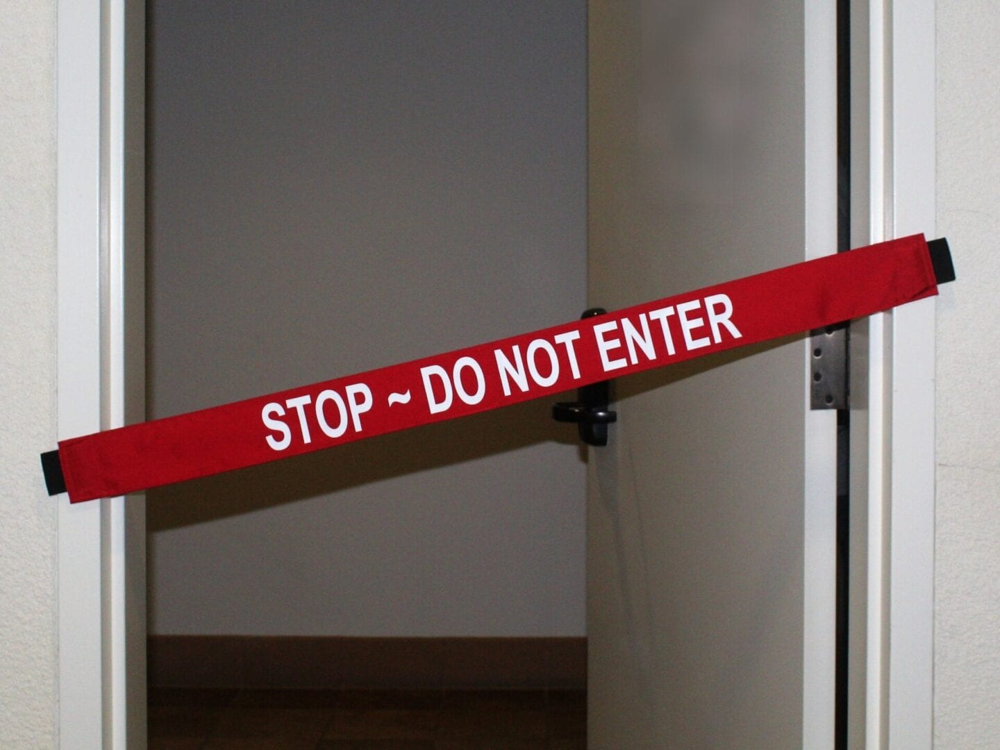 """""""Stop, Do Not Enter"""" Signage Placed on a Doorway"""